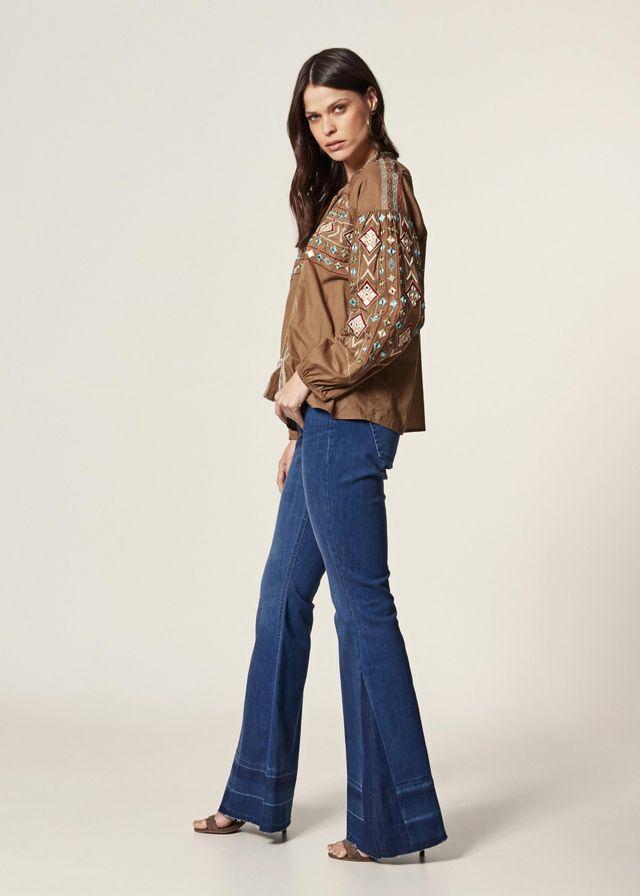 7a79732f75 Calça Jeans Flare Barra Desfeita Calça Jeans Flare Barra Desfeita